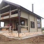 покраска фасада в деревянного дома